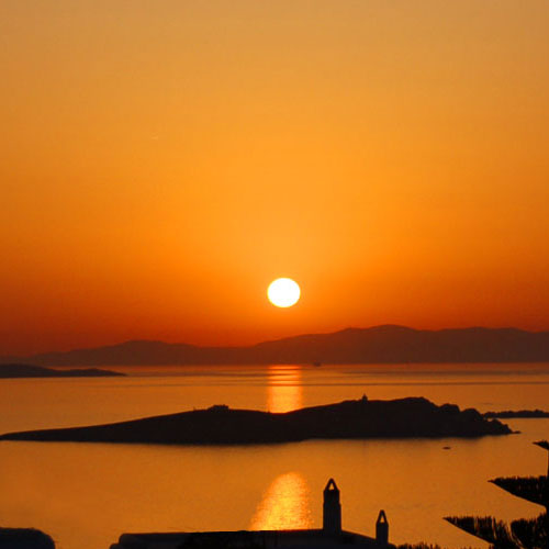 Enjoy the enchanting sunset from our Mykonos Rooms